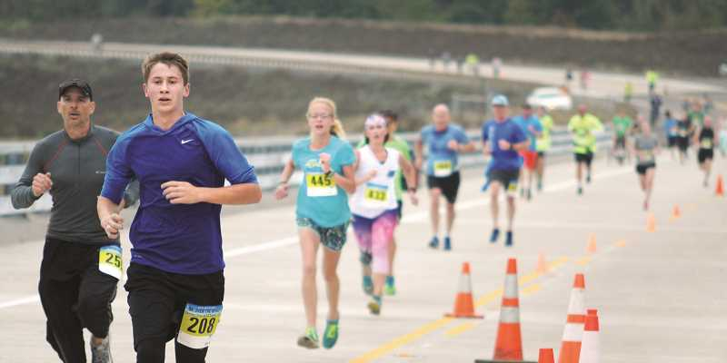 GARY ALLEN - More than 285 people of all ages ran and walked a five kilometer loop southwest of Newberg toward Dundee during Play on the Bypass Saturday morning.