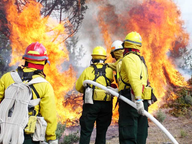 PMG PHOTO - More than 8,000 personnel from different agencies have been deployed to fight 1,903 separate wildland fires across the state. That's more than one-third of the personnel deployed to combat wildfires nationwide.