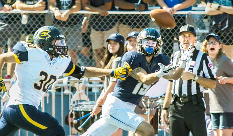 GRAPHIC CONTRIBUTOR BEN LUDEMAN - Senior wide receiver Brad Lander locks in on a touchdown pass Saturday during George Fox's 44-0 drubbing of Wisconsin-Eau Claire. With the win, the Bruins (3-1) were listed eighth among 'other teams receiving votes' in the latest D3football.com Top 25 poll.
