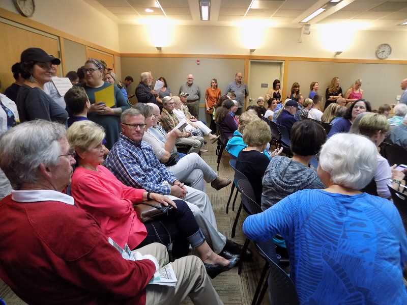 GAZETTE PHOTO: RAY PITZ - A packed meeting greeted the Sherwood City Council for the second week in a row. Many of those who attended appeared to support signing a contact with the YMCA of Columbia-Willamette, provider of city recreation facility services for almost 20 years.