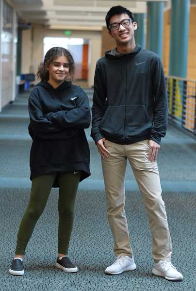 SPOKESMAN PHOTO: CLARA HOWELL - Katie Vedder (left) and Dennis Tang (right) spent a few days making a website to promote their tutoring business this summer and launched it at the start of the school year.