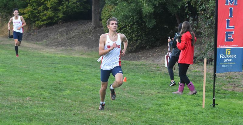 TIMES PHOTO: MATT SINGLEDECKER - Westview senior Nathan Willins won in his return to the cross country course against Beaverton and Liberty.