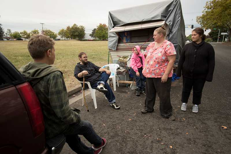 TIMES PHOTO: JAIME VALDEZ - The Kelvin family stands by the trailer they live in along SW Fifth Street near Southwest Western Avenue. Pictured from left; Colton,14, Josh, father, Gabe,10, Kelly, mother, and Dakota,16.