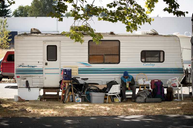 TIMES PHOTO: JAIME VALDEZ - A homeless person is seen hanging out by his camper along Southwest Fifth Street near Western Avenue.