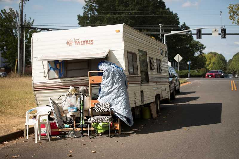 TIMES PHOTO: JAIME VALDEZ - Homeless people have moved their campers along Southwest Fifth Street near Western Avenue.