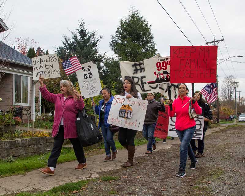 INDEPENDENT FILE PHOTO - Woodburn residents marched last year following the presidential election to speak out against President Donald Trump's stance on issues like immigration.
