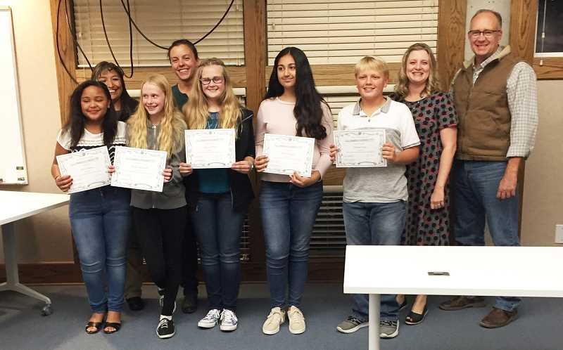 SUSAN MATHENY/MADRAS PIONEER - JCMS students who scored a 3 or 4 level on the Smarter Balanced test in both math and language arts were recognized at Monday night's board meeting. Pictured from left front are, Wesley Thomas,  Brook Delamarter,  Amanda Plant,  Karman Sangha and TJ Stout. Congratulating them at back are board members Laurie Danzuka, left, Jamie Hurd, Courtney Snead and Stan Sullivan.