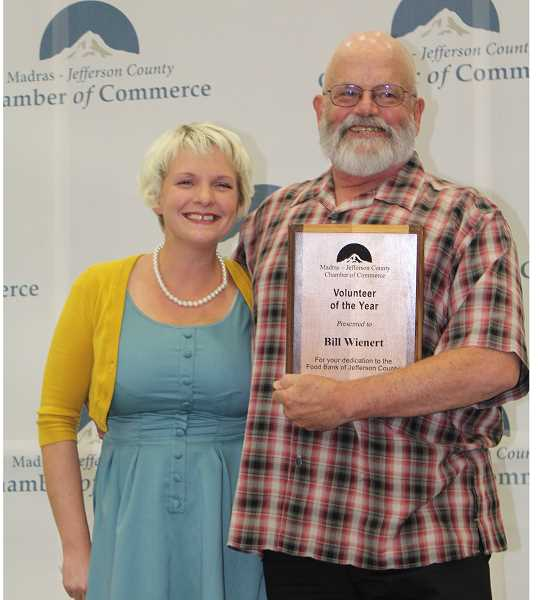 HOLLY M. GILL - Austin Cooper, left, presents Bill Wienert with the Volunteer of the Year award for his community work.