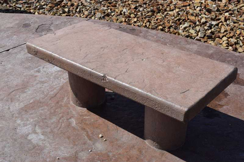 PHOTO BY SARA PUDDY - Two of the monument's concrete benches have also been damaged.