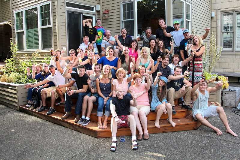 PHOTO COURTESY OF JNEANNE THEUS - The still-growing Gregoire family poses for a group photo in the backyard of Tom and Alice's Lake Oswego home. 'You know how some people collect cats and dogs? These people collect children,' daughter J'Neanne Theus says.