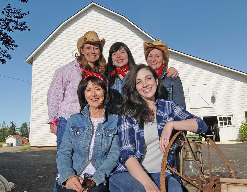 REVIEW PHOTO: VERN UYETAKE - Parks & Recreation staff pose for a photo at the Luscher Farm Barn Dance. Top row: Dawn Kolb, Jamie Inglis and Mary Kelly. Bottom row: Kathy Schilling and Madeline Marin-Foucher.
