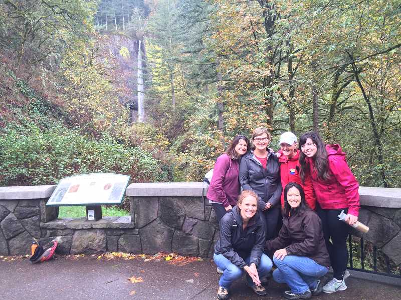 SUBMITTED PHOTO: JAMIE INGLIS - Parks & Recreation staff pose for a photo at Multnomah Falls during a work retreat. Bottom row: Dawn Kolb and Kathy Schilling, Top row: Debbi Campbell, Dawn Grunwald, Mary Kelly and Jamie Inglis.