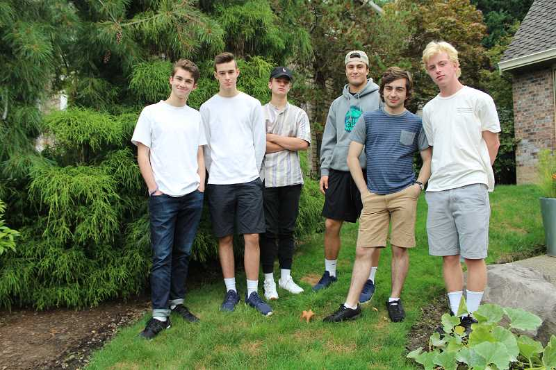 REVIEW PHOTO: SAM STITES - Sound Pharmacy band members gather outside their practice space in the garage of Spencer Brown's home. From left: Jackson Schelonka, Spencer Brown, Michael Campanelli, Laz Glickman, Spencer Schillinger and Cole Schillinger.