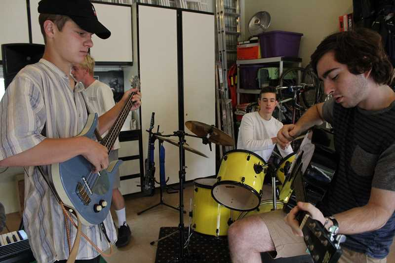 REVIEW PHOTO: SAM STITES - Michael Campanelli and Spencer Schillinger play off each other's rhythms during a jam session at Spencer Brown's house.