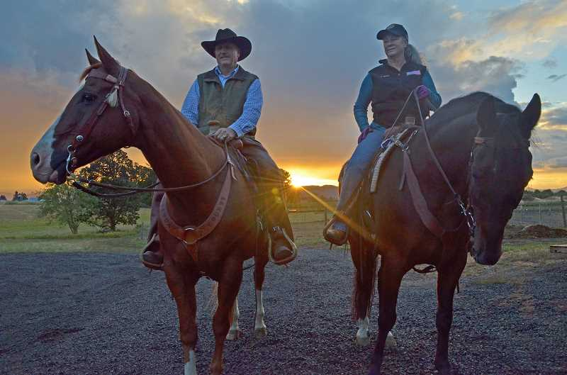HILLSBORO TRIBUNE PHOTO: JOHN WILLIAM HOWARD - Washington County Sheriffs Office Commander Gil MacGregor, left, and county resident Diane Long take a break from training to enjoy the sunset Sept. 21 at a farm near Forest Grove. MacGregor, riding Bo, is one of several deputies to ride with the Sheriffs Posse. Long rides her horse Ranger, and particiates alongside her husband, Joe.