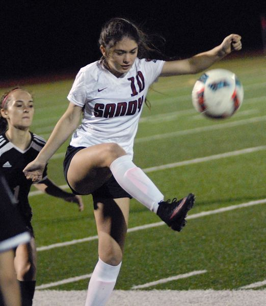 SANDY POST: MATT RAWLINGS - Sandy defender Katelyn Bien clears the ball away.