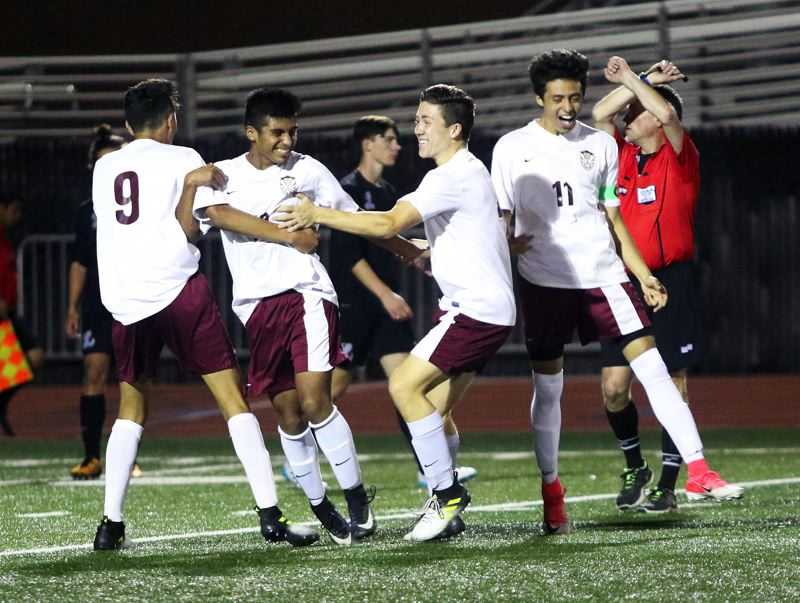 DAN BROOD - The Timberwolves celebrate following a goal by junior Daniel Valdovinos (second from left) during Thursday's match with Lakeridge.