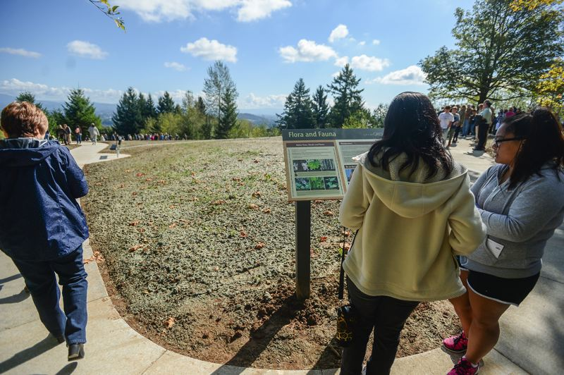 FILE PHOTO - Close to 100 people gathered atop Hogan Butte Saturday morning for the dedication of Hogan Butte Nature Park. It features interpretive signs, native plants, and an amazing view of a half-dozen Cascade Range mountains.