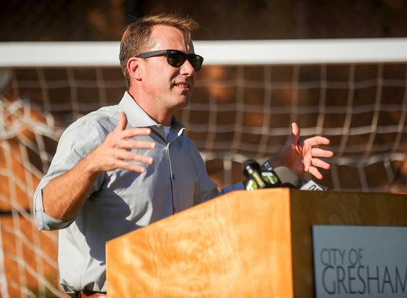 OUTLOOK PHOTO: JOSH KULLA - Gresham Mayor Shane Bemis speaks Thursday at the dedication of a new futsal facility at the Rockwood Boys and Girls Club that will bear his name. The Shane Bemis Courts are sponsored by the Portland Timbers and Operation Pitch Invasion, which is affiliated with the Timbers Army supporters club.