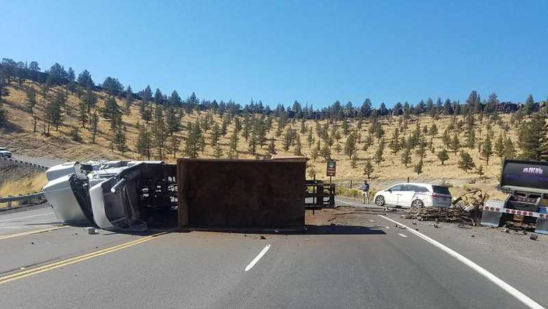 PRINEVILLE POLICE DEPARTMENT - The dump truck on the left collided with a white Honda van and the Peterbilt truck on the right collided with the metal on the road.