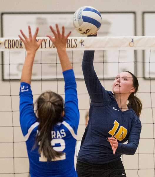 LON AUSTIN/CENTRAL OREGONIAN - Kerigan Waibel goes up for one of her six kills Tuesday night against the Madras White Buffalos. The Cowgirls won the match in straight sets.