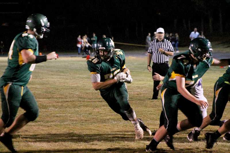 PIONEER PHOTO: CONNER WILLIAMS - Colton senior Zemar Smith finds a gap to run through during the Vikings' 31-27 win over Jefferson on Sept. 15.