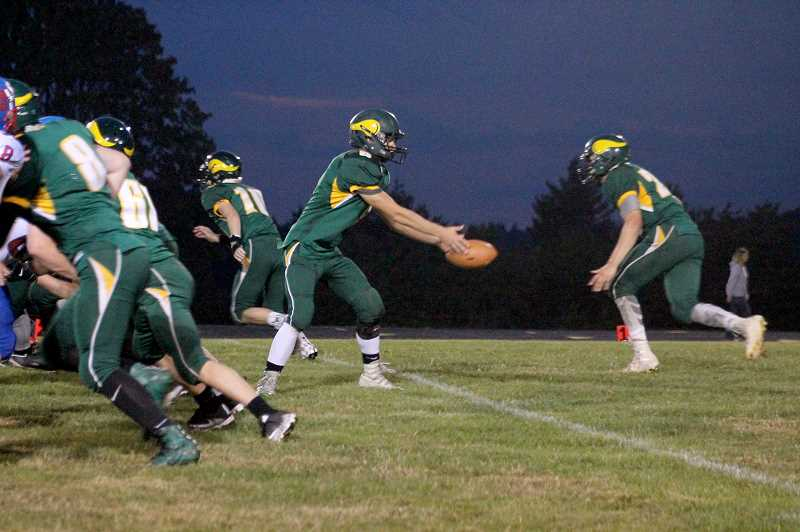 PIONEER PHOTO: CONNER WILLIAMS - Colton senior Zemar Smith (right) takes a pitch from sophomore quarterback Wyatt Earls during the Vikings' 28-21 win over Central Linn on Sept. 22.