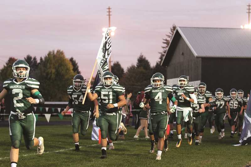 PHIL HAWKINS - The North Marion football team comes rushing out to the field for their 26-12 homecoming win over Yamhill-Carlton on Friday.