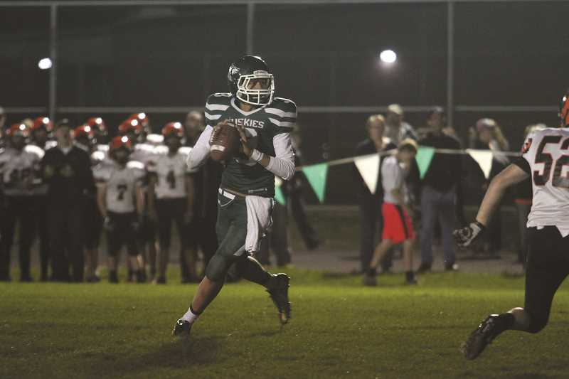 PHIL HAWKINS - North Marion quarterback Sergio Jimenez threw for 182 yards and two touchdowns, and scooped up a pair of turnovers on the other side of the ball in the Huskies' 26-12 win over Yamhill-Carlton.