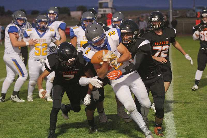 WILL DENNER/MADRAS PIONEER - Stanfield and Culver fought to the closing seconds of the game, trading blows in a run-heavy game. Stanfield senior Adrian Renner (2) tallied 199 yards and one touchdown on 16 carries.