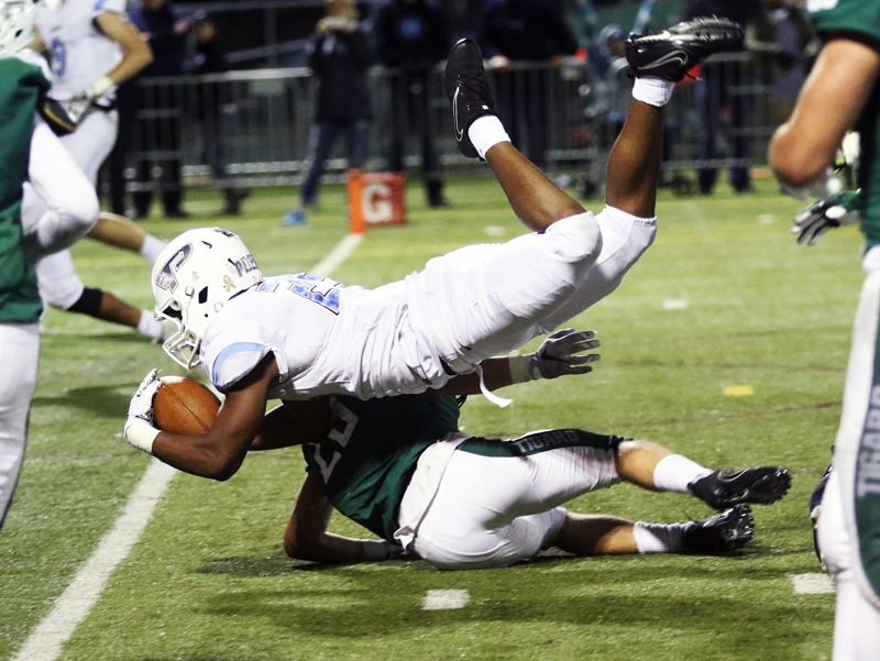 DAN BROOD - Lakeridge sophomore Jalen John gets over the goal line for the first of his two touchdowns against Tigard.