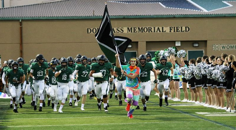 DAN BROOD - The Tigard High School football team takes the field prior to Friday's game against Lakeridge.