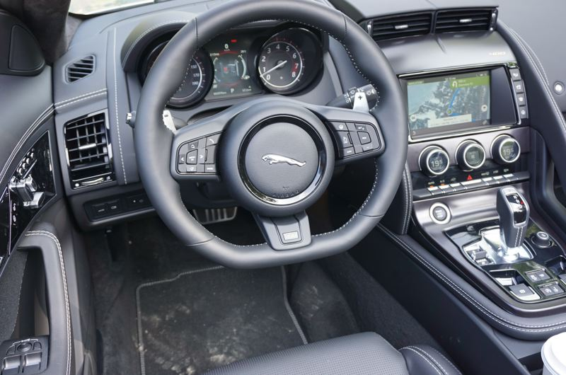 PORTLAND TRIBUNE: JEFF ZURSCHMEIDE - Inside, you get a sporty luxury interior with all the latest technologies, plus nifty yellow top-stitching on the seats and steering wheel.