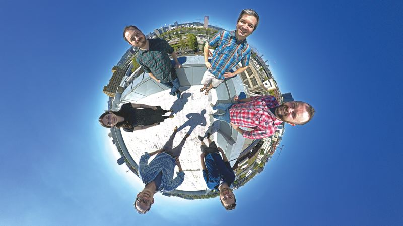PHOTO SHOT BY BRAD GILL WITH A CANON 6D, WITH AN 8 MM FISHEYE LENS ON A PANO HEAD. - (clockwise from 9 o'clock) Rachel Bracker, VR Editor + Producer; Matt Rowell, Co-Founder + President; Thomas Hayden, Co-Founder;   Brad Gill, Co-Founder; Forrest Brennan, VR Editor + Producer;  Matthew Clarke, Creative Director + Director of Business Development on the roof of their building.