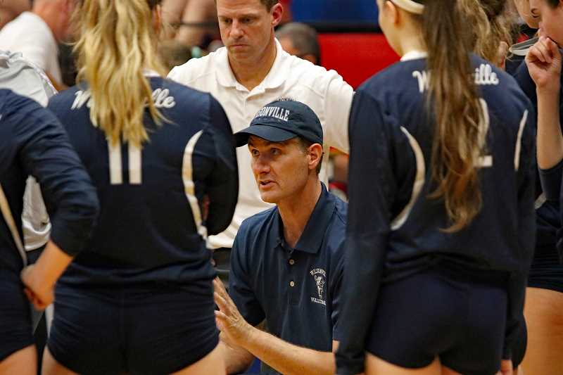 PAMPLIN MEDIA GROUP PHOTO: JIM BESEDA - Wilsonville coach Nathan Blakenship talks strategy during a timeout the the Wildcats trailing 12-10 in the fifth set of Thursdays Northwest Oregon Conference volleyball match at La Salle Prep.