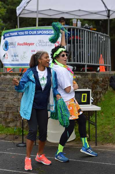 SPOKESMAN PHOTO: CLARA HOWELL - Principal Angela Freeman (left) and P.E. teacher Sue Bynum (right) groove to the music while students line up for the Fun Run.