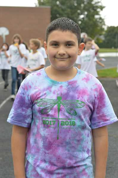 SPOKESMAN PHOTO: CLARA HOWELL - Eric Lewis, 9, finishes up the Fun Run in his Boones Ferry Primary School t-shirt.