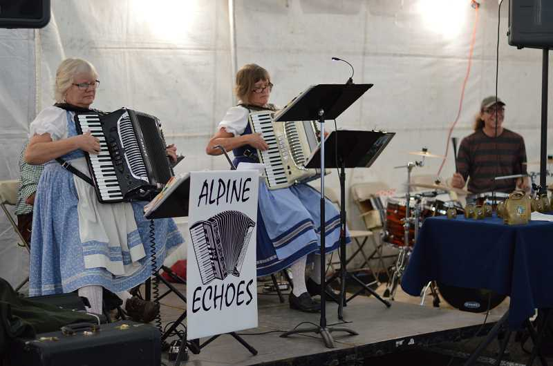 TIDINGS PHOTO: CLARA HOWELL - The Alpine Echoes Band performs traditional songs for people at Oktoberfest in West Linn.
