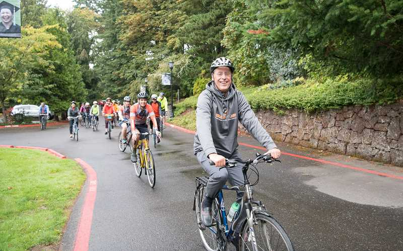 COURTESY PHOTO: LEWIS & CLARK COLLEGE - Wim Wiewel kicks off his first day as president of Lewis and Clark College on Monday with a ceremonial bike ride, accompaied by faculty, students and staff from the private liberal arts school.