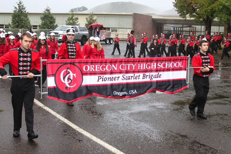 SUBMITTED PHOTOS - Oregon City High School's marching band heads out for last year's homecoming parade, starting from Gardiner Middle School.