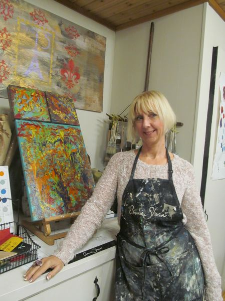 PHOTO BY ELLEN SPITALERI - Big White Goose owner Cheryl Frampton stands in front of an art therapy painting, using Annie Sloan's Chalk Paint.