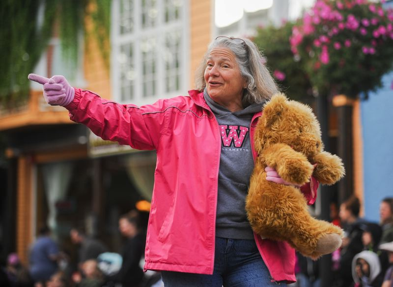 OUTLOOK PHOTO: JOSH KULLA - State Representative Carla Piluso waves to the crowd on Main Avenue Saturday during the Gresham Soroptimist Teddy Bear Parade.