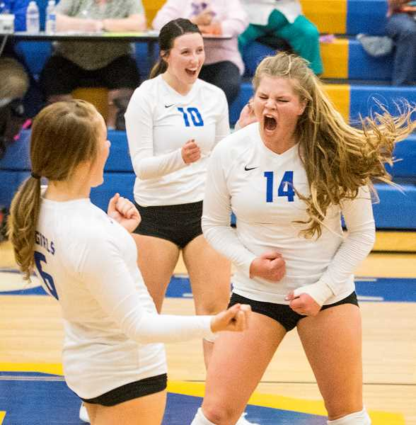LON AUSTIN/CENTRAL OREGONIAN - Raegan Wilkins, left, Kerigan Waibel, center, and Kenna Woodward celebrate after a big point during the third set of the Cowgirls' victory over the Estacada Rangers on Thursday.