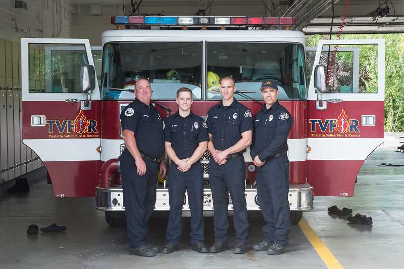 HILLSBORO TRIBUNE PHOTO: CHRISTOPHER OERTELL - Captain Brooks Frank, firefighter Galen Hunt, firefighter Matt Cox and Engineer Chris Tompkins pose in front of Engine 64 at the remodeled Tualatin Valley Fire and Rescue Station 64.