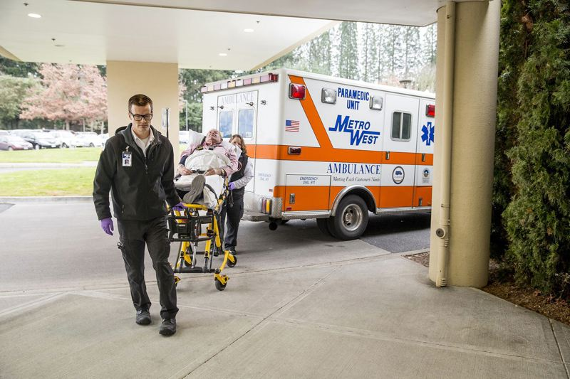 PAMPLIN MEDIA GROUP FILE PHOTO - A heart failure patient is brought into Legacy Meridian Park Medical Center on a stretcher. A new icitizen poll says most Oregonians would oppose a $600 million tax on health insurance policies.