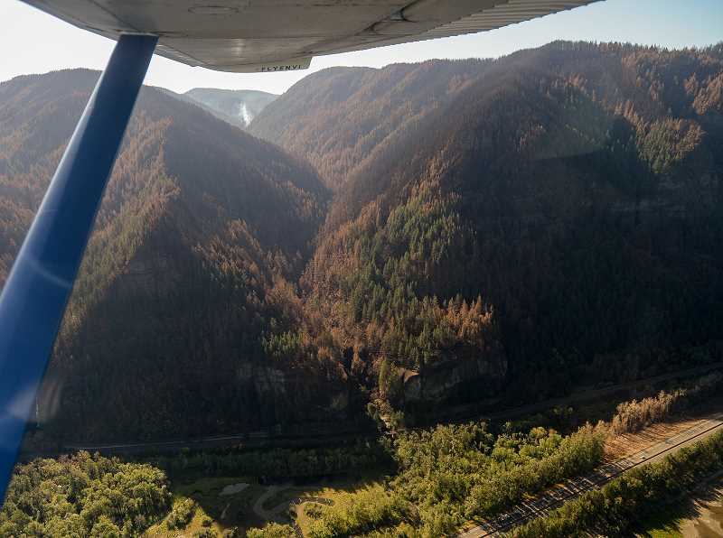 OUTLOOK PHOTO: JOSH KULLA - Smoke continues to rise in isolated parts of the Eagle Creek Fire, such as in this photo of the Oneonta Gorge, taken Tuesday, Oct. 3, during a flight with Envi Adventures of Troutdale.