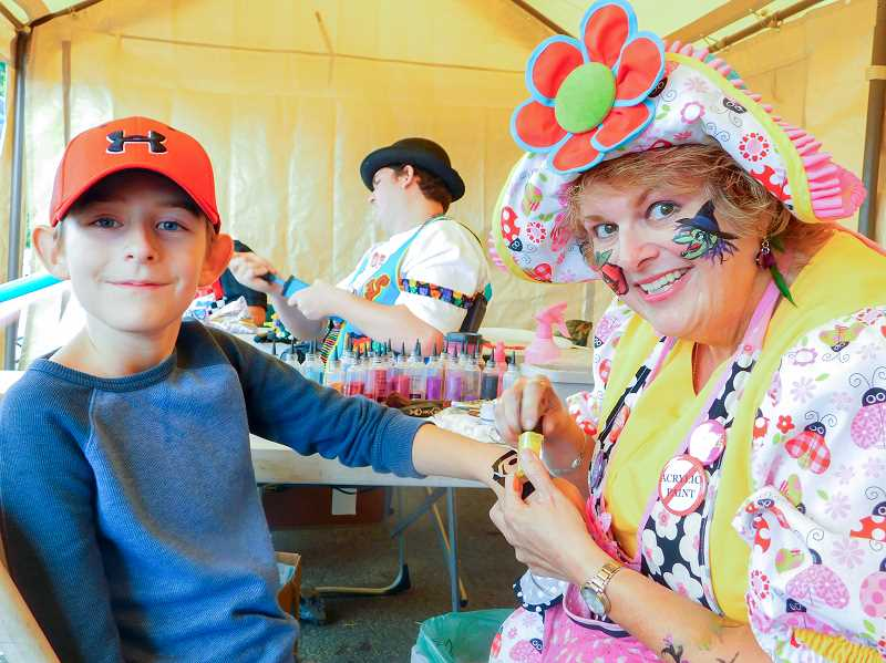 ESTACADA NEWS PHOTO: EMILY LINDSTRAND - Face painting was one of many activities that young Harvest Festival attendees enjoyed.