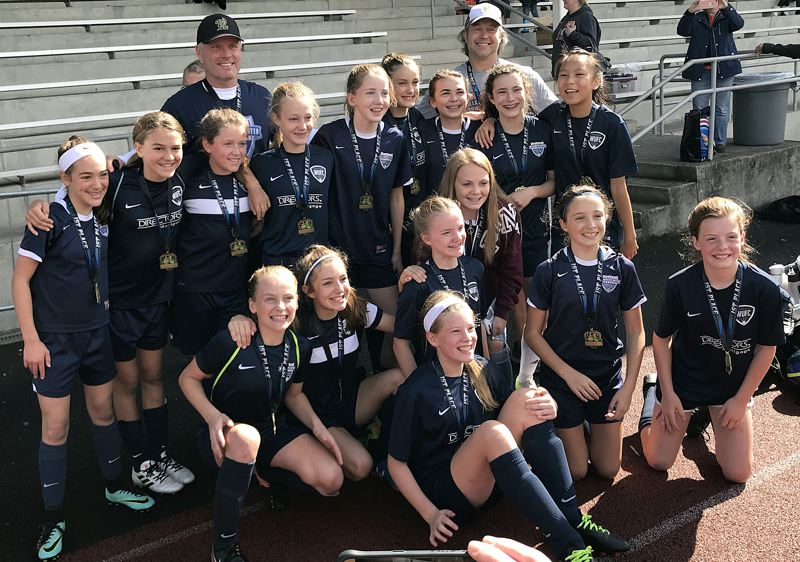 SUBMITTED PHOTO - The 7th grade girls BOOM! soccer team included (front row) Zoey Boudette, (middle row, left to right) Eva Murray, Cienna Lee, Ava Hoem, Jacki Craven, Lily Campbell and Reese Wasmund, and (back row) Audrey Jacklyn, Ryleigh Freeman, Karah Highland, coach Chris Hoem, Emily Fuller, Ruby Michelon, Amelia Brown, Marina Sullivan, coach Dewy Campbell, Margot Pressman and LuLu O'Kain. Not pictured is Kaydence Monson.