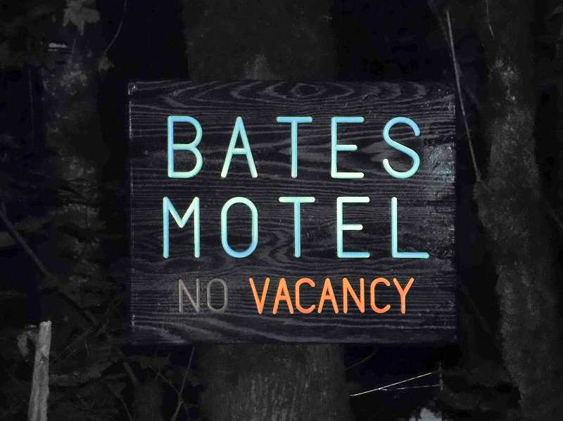 ESTACADA NEWS PHOTO: EMILY LINDSTRAND - A sign for the Bates Motel — a nod to Alfred Hitchcocks film Psycho — lights up on the Halloween Fantasy Trail.