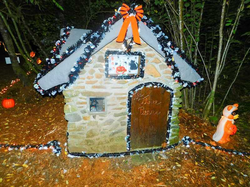 ESTACADA NEWS PHOTO: EMILY LINDSTRAND - Wayne Wenzel build the structures along the Halloween Fantasy Trail, including this house for the three bears.